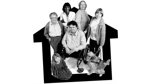 Group of people sitting in outline of a house